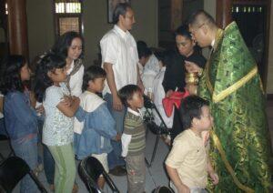 Children Receiving Communion in Indonesia