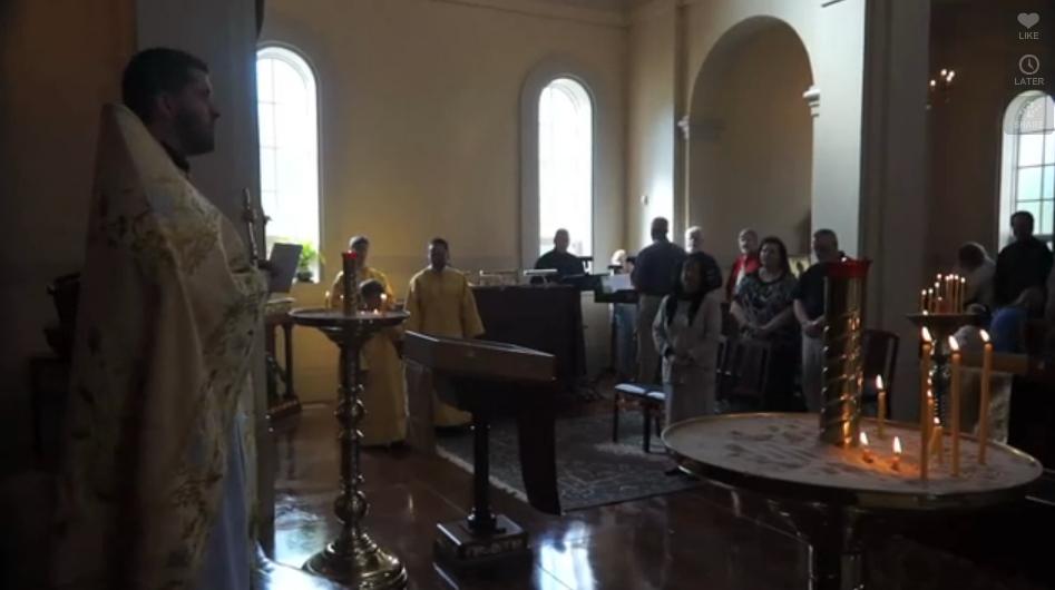 Priest dismissing the congregation.