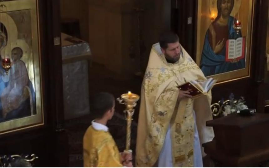 Priest reading the Gospel.