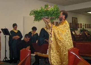 Priest processing with tray.