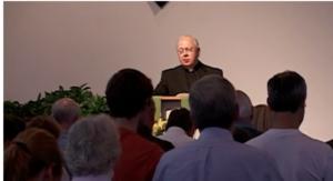 Fr. Wilbur Ellsworth giving the invocation.