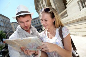 13808570-Couple-of-tourists-looking-at-city-tour-map--Stock-Photo